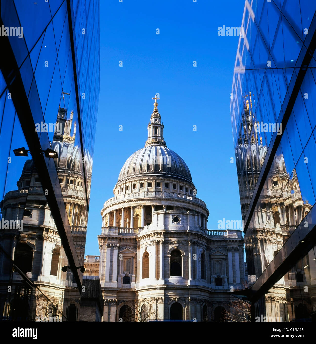 A view of St Pauls Cathedral and reflection of the building on glass walls of  One New Change shopping mall in Central - Stock Image
