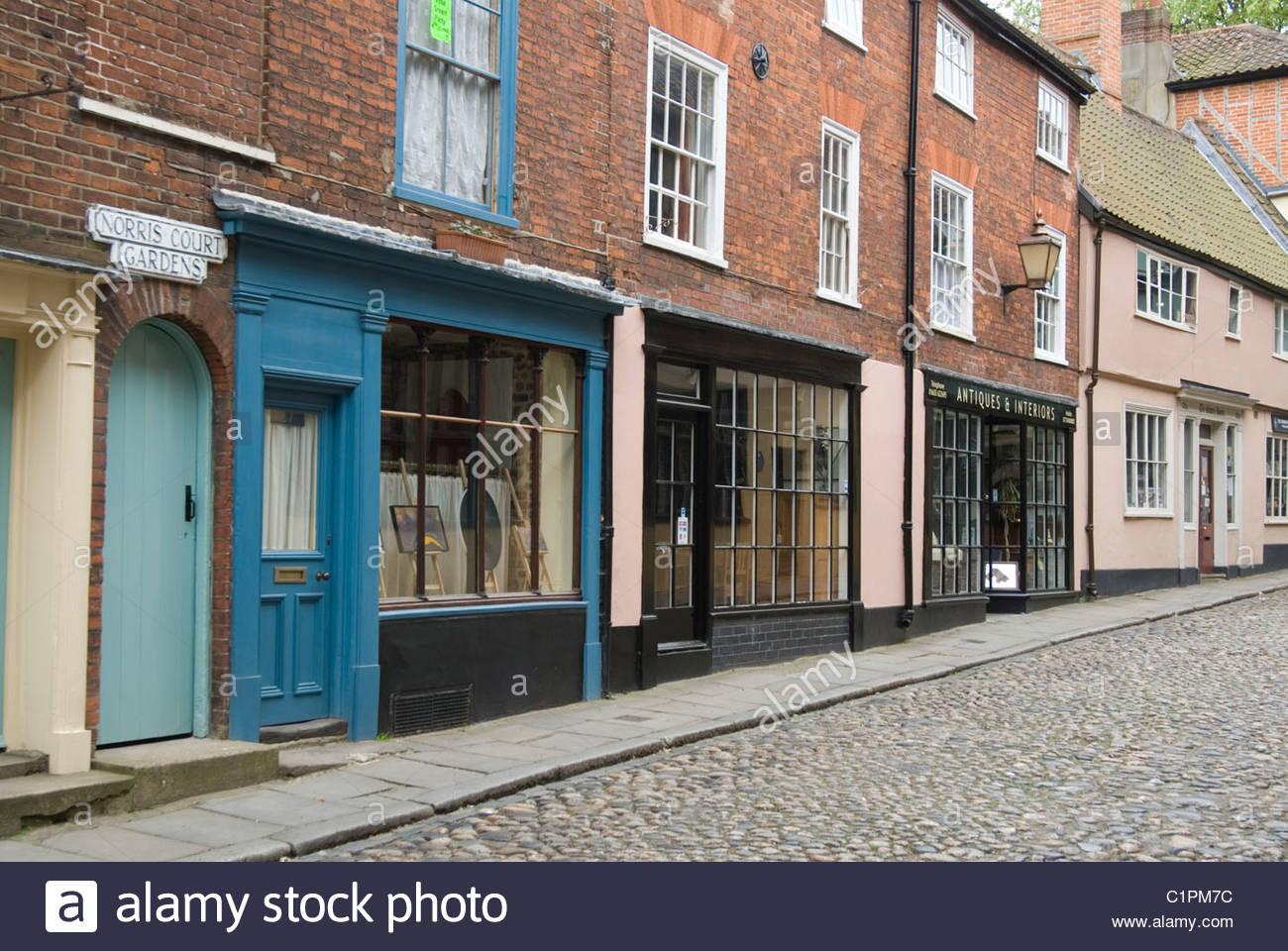 UK, England, Norfolk, Norwich, Elm Hill, row of shops - Stock Image