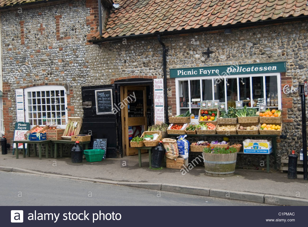 England, Norfolk, Cley next the Sea, fruit and vegetables outside shop - Stock Image