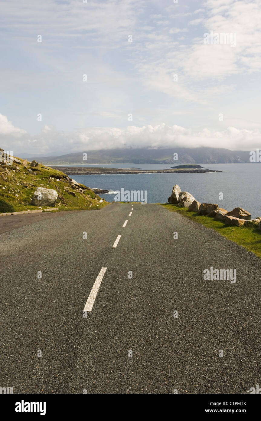Republic of Ireland, County Mayo, Achill Island, road leading to sea - Stock Image