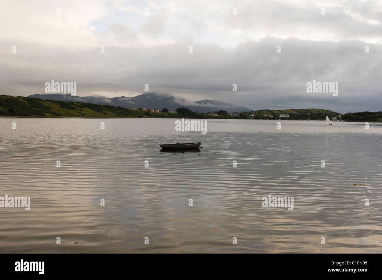 Republic of Ireland, County Mayo, Achill Island, boat on saltwater inlet - Stock Image