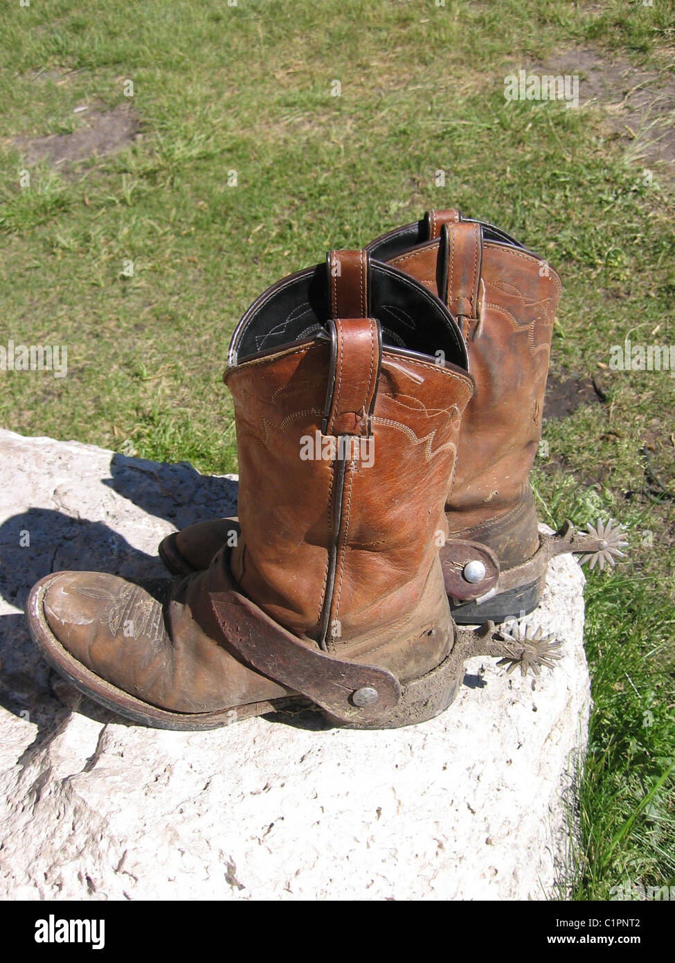 ba12bea24f6 Worn Leather Cowboy Boots Usa Stock Photos & Worn Leather Cowboy ...