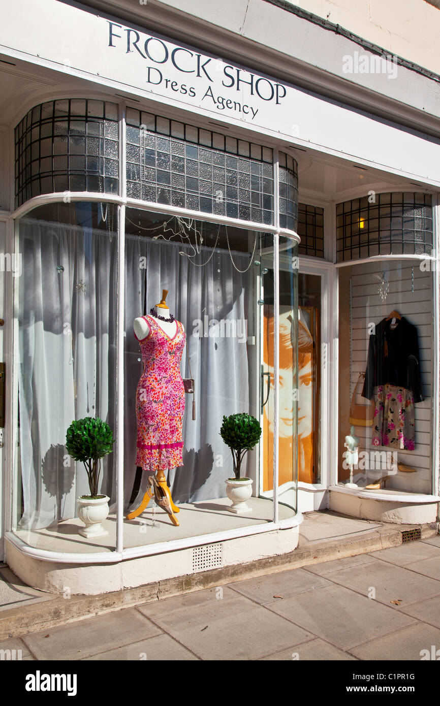 A dress shop window in the provincial English market town of Warminster in Wiltshire, England, UK - Stock Image