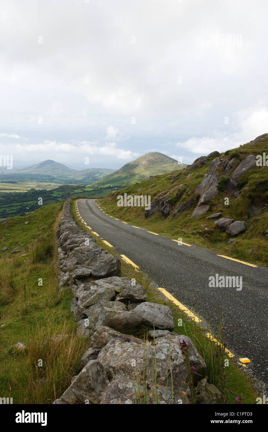 Republic of Ireland, County Cork, Healy Pass, road through with Caha Mountains in background - Stock Image