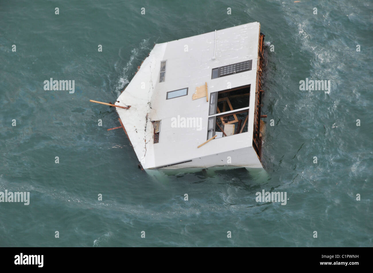 Aerial photo taken March 14 2011 of a house floating at sea near Sendai, Japan, in the aftermath of the earthquake Stock Photo
