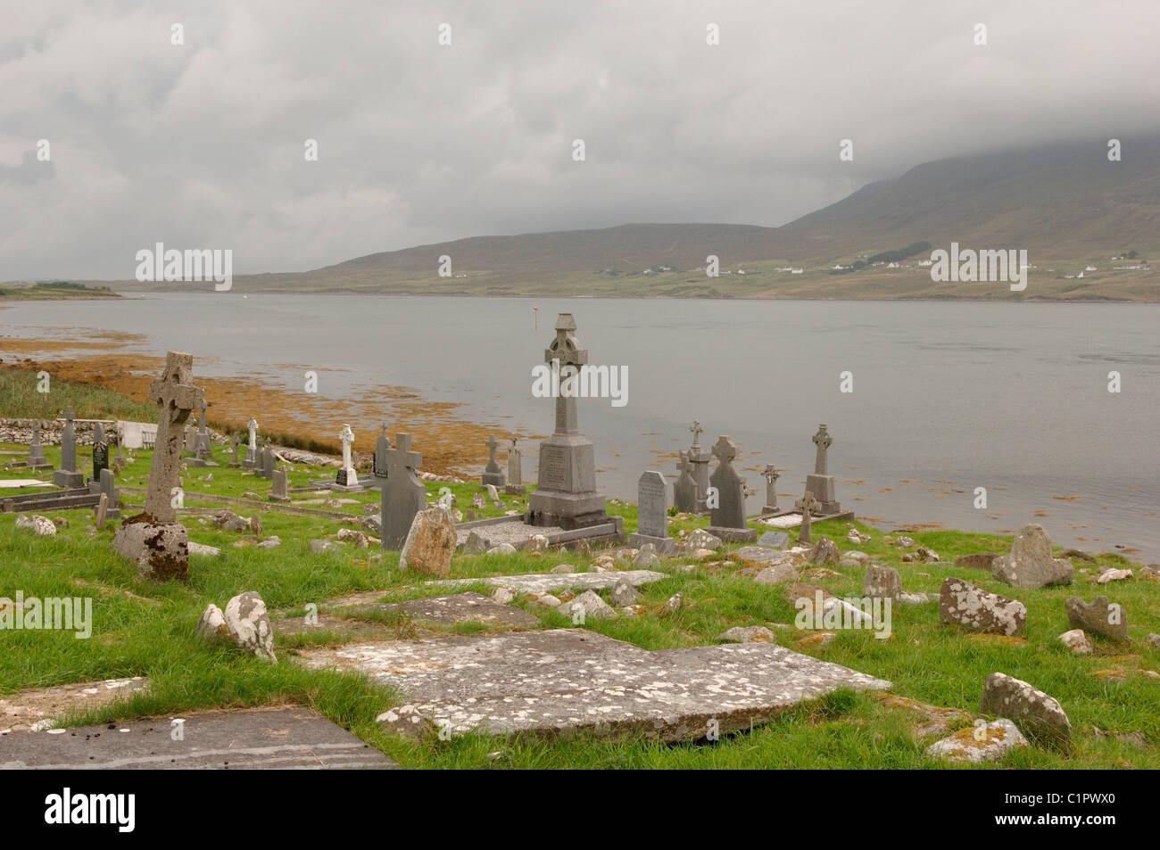 Republic of Ireland, County Mayo, Achill Island, Kildownet Graveyard overlooking Achill Sound - Stock Image