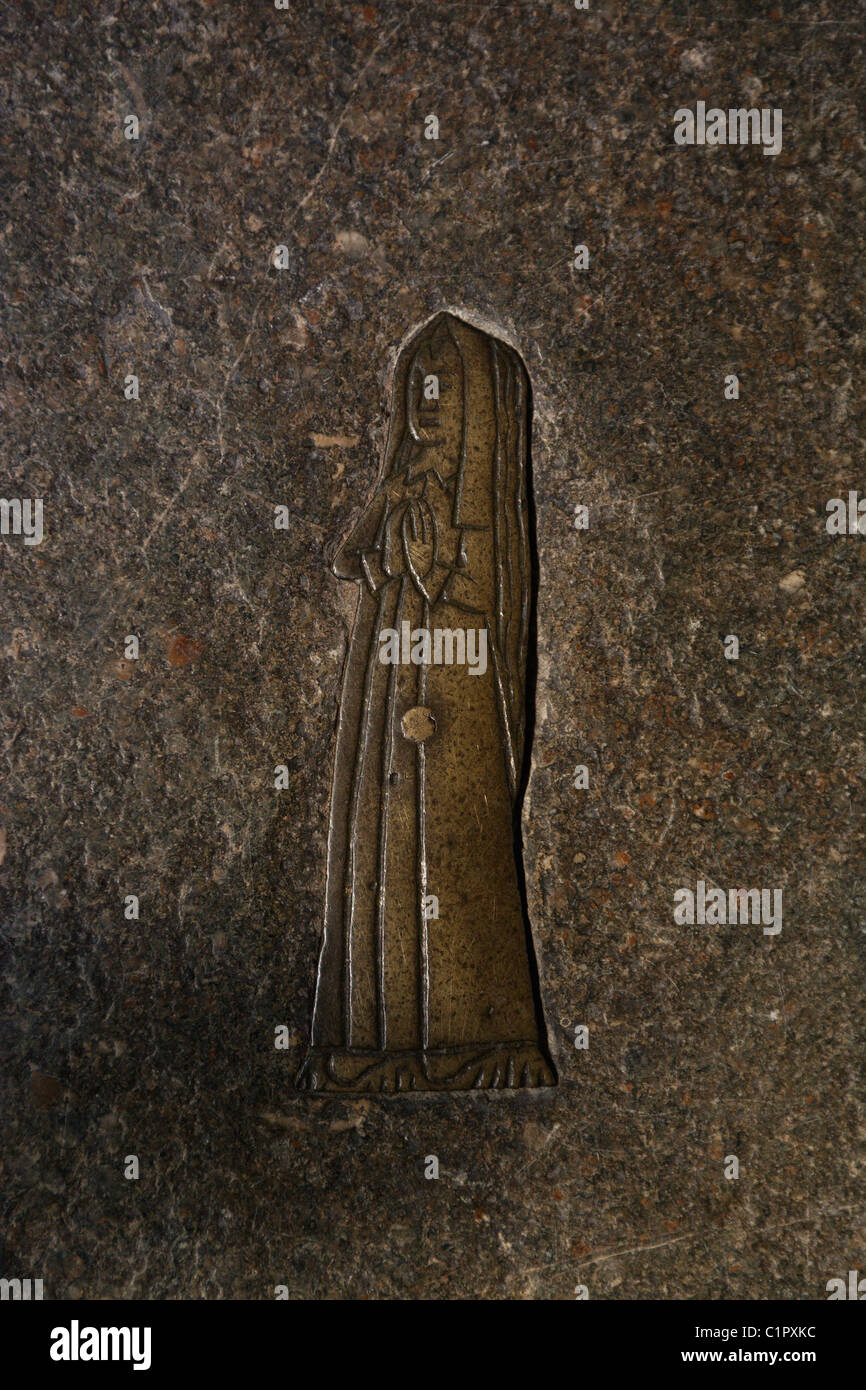 England, Cotswolds, Northleach, Church of St. Peter and St. Paul, brass figure on stone tomb - Stock Image