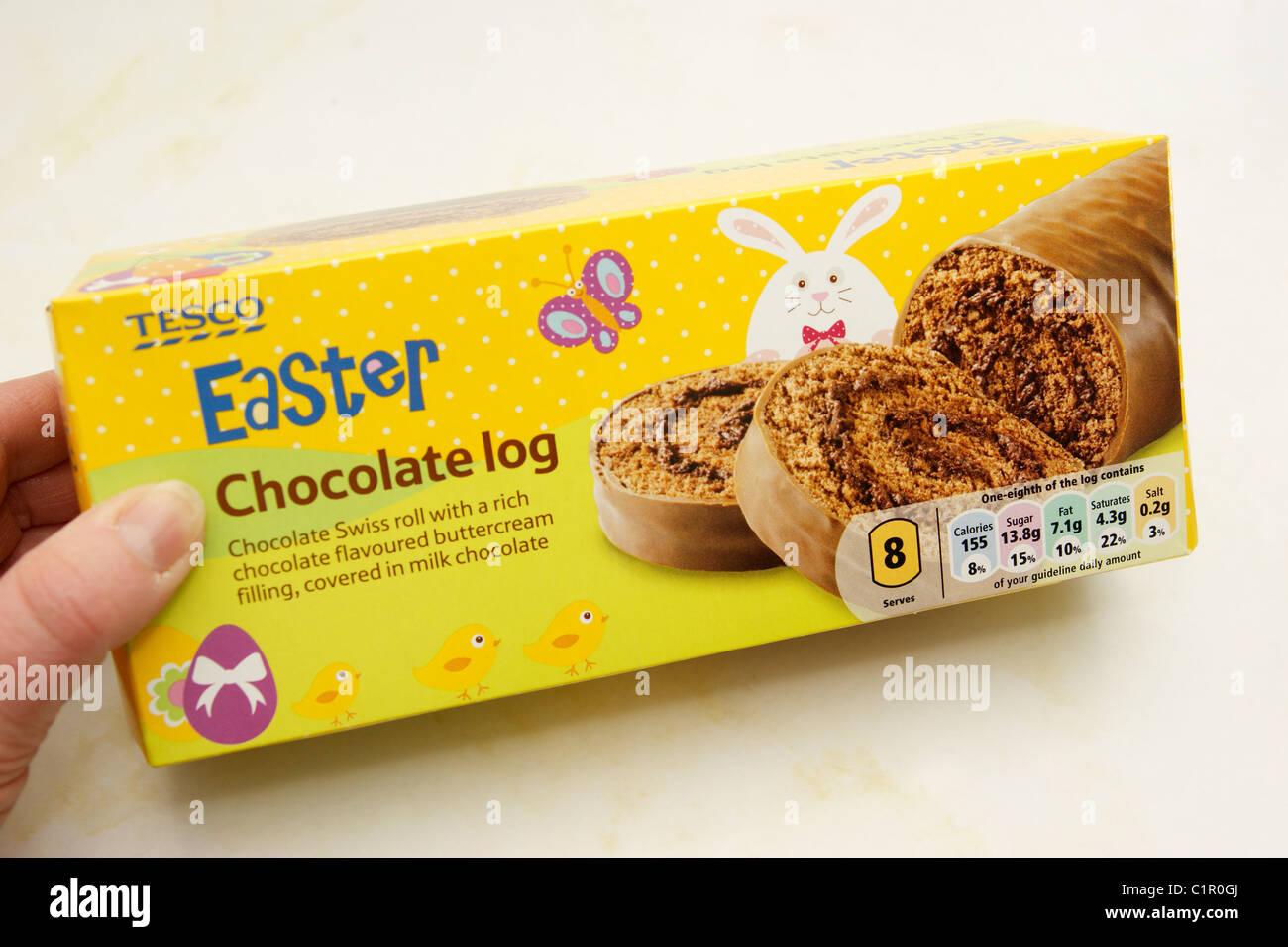 woman holding a Tesco chocolate Easter log Stock Photo