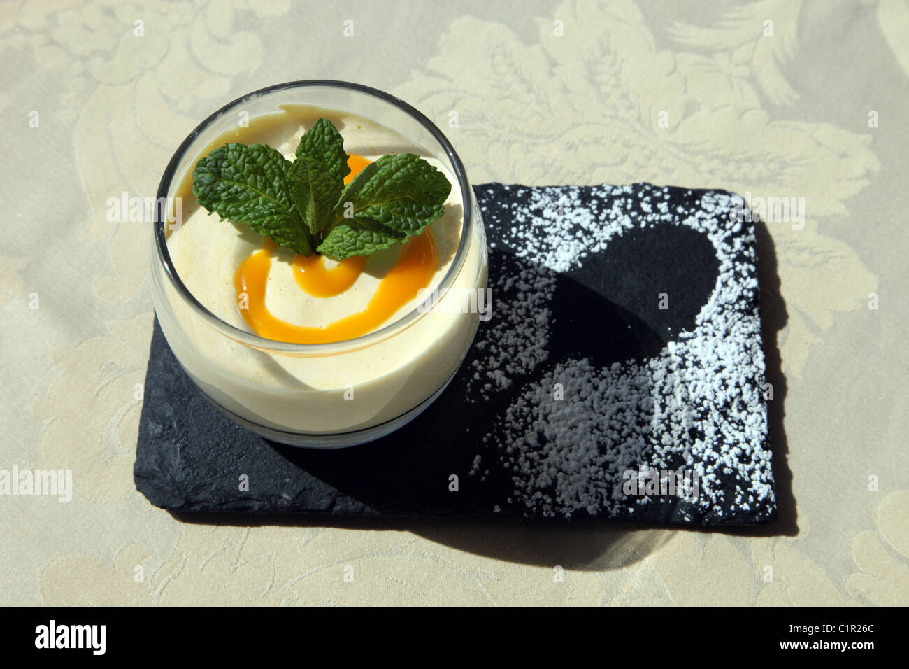 Mango Mousse, pudding served at Abrigo da Montanha Restaurant, Figueira da Foz, Portugal - Stock Image