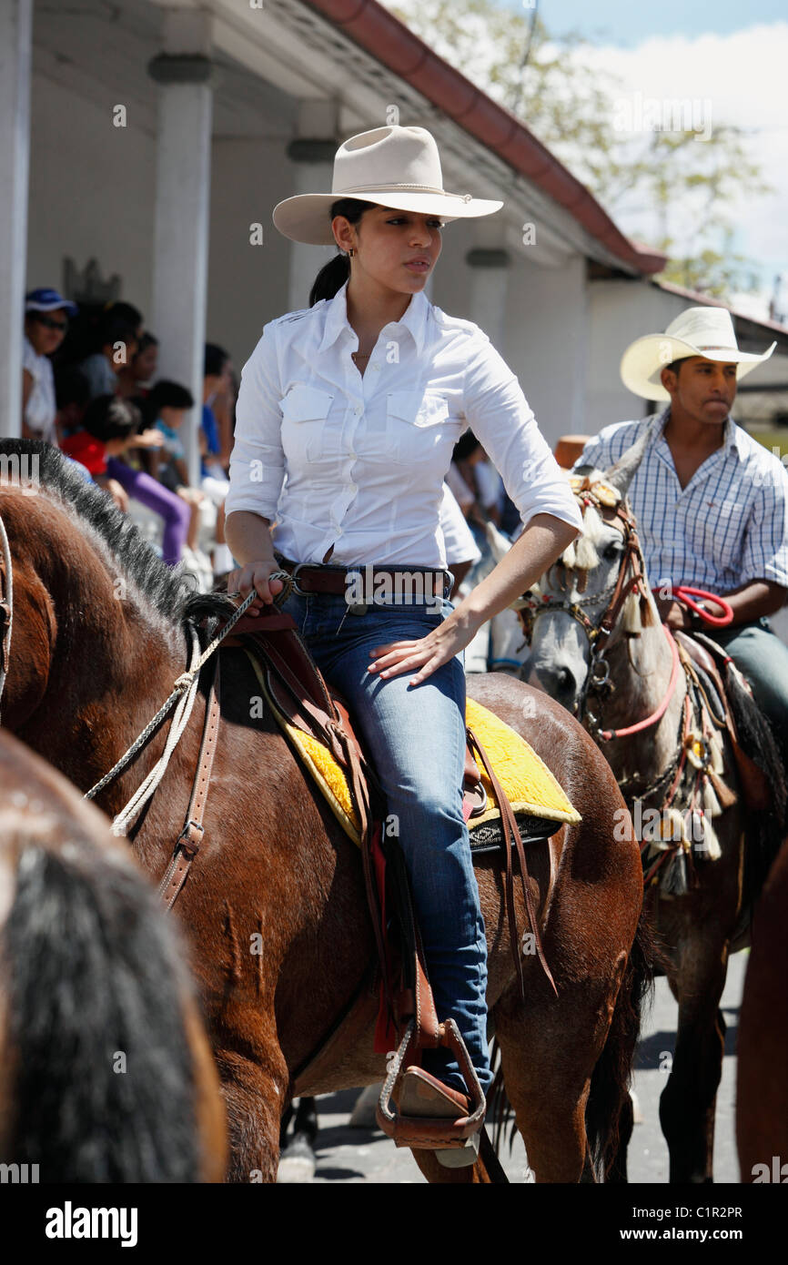 Woman on a horse in the civic festival horse parade in Liberia, Costa Rica - Stock Image