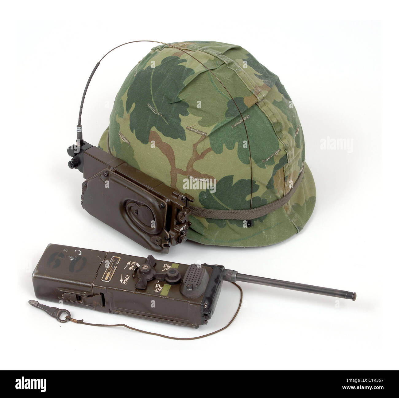 American Vietnam period M1 pattern GI helmet with squad level radio receiver AN/PRR-9 and transmitter AN/PRT-4A. Stock Photo
