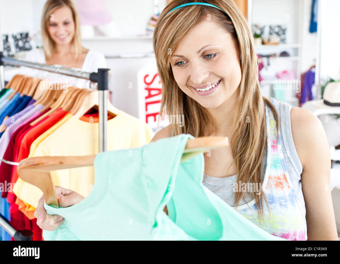 Happy woman selecting item - Stock Image