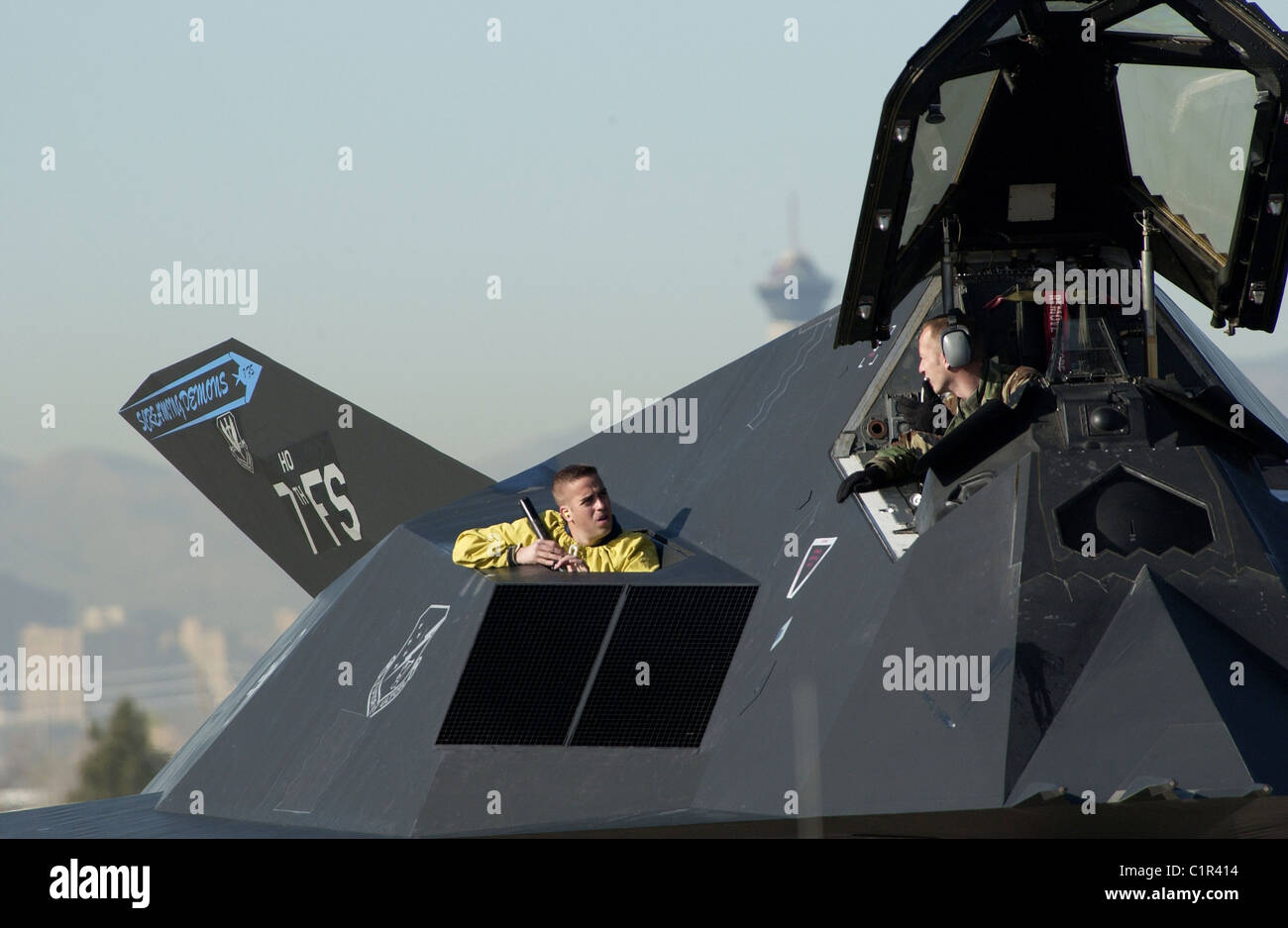 crew chiefs pre-flight the F-117 Nighthawk stealth fighter during preparation for launch at Nellis Air Force Base, - Stock Image