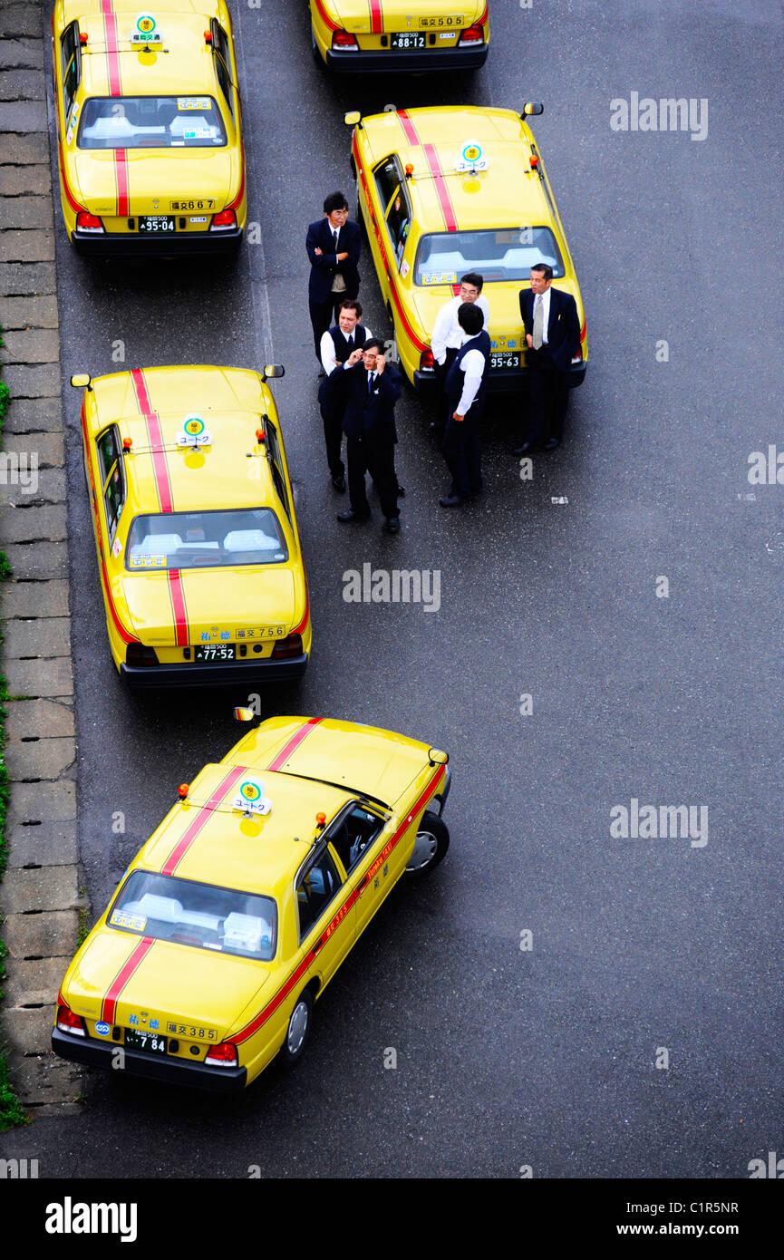 Taxis waiting for cruise ship passengers to disembark in Fukuoka, Japan - Stock Image