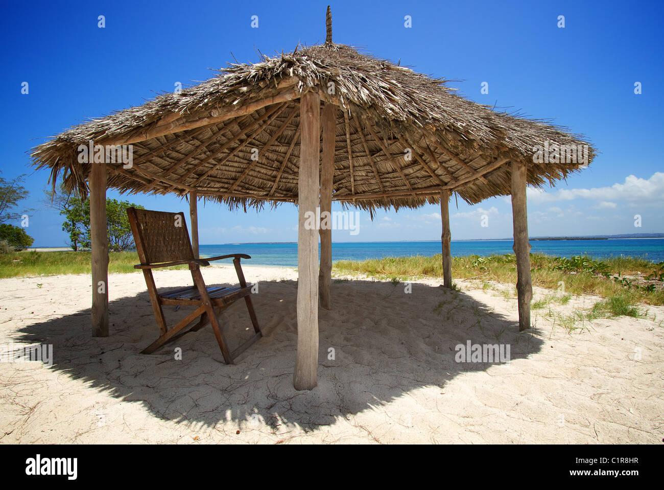 Beach hut and chair Mbuya desert island Tanzania - Stock Image