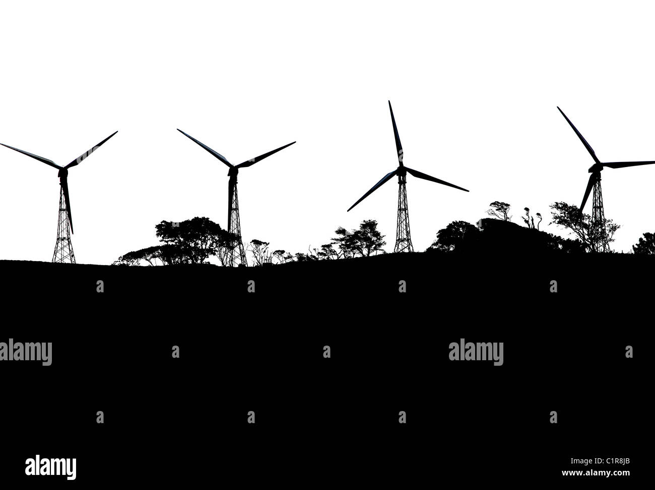 Wind turbine silhouettes on a hilltop above lake Arenal, Costa Rica - Stock Image