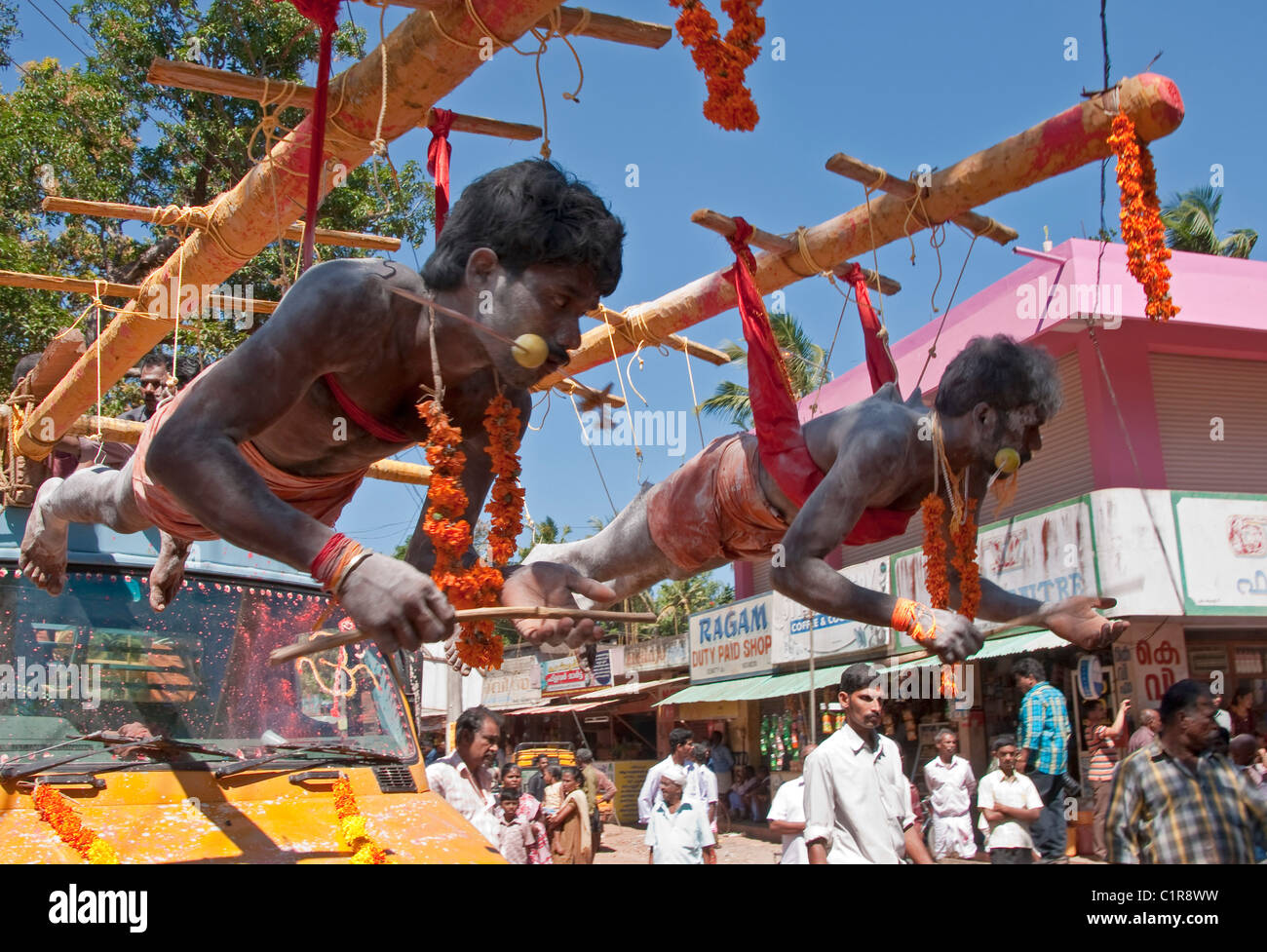 Tamil devotees suspended by fish hooks for Thaipusam Festival at Muruga or Murugan (Hindu god of war) Temple - Stock Image