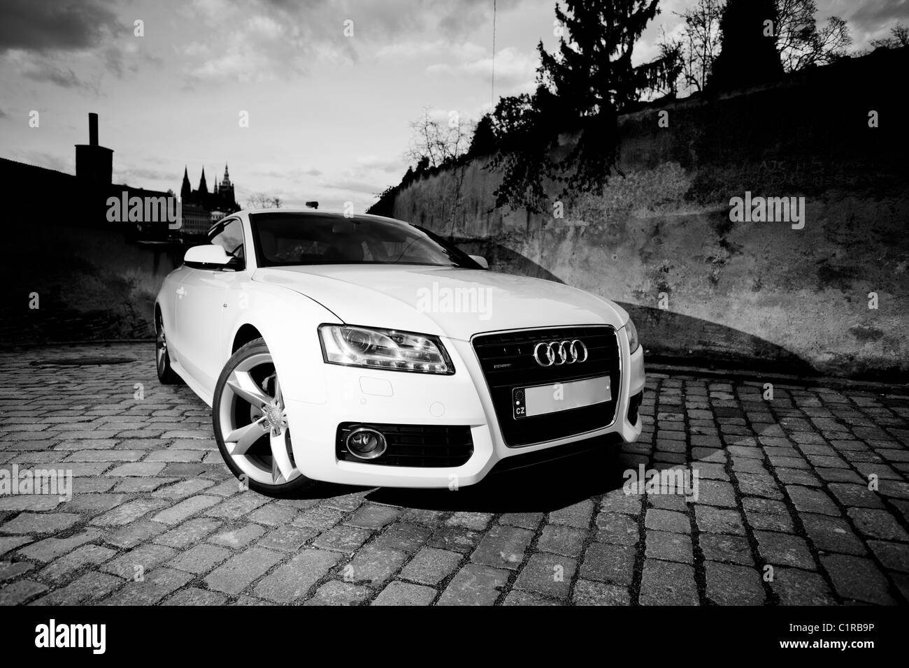 White Sports Car parked in the street - Stock Image