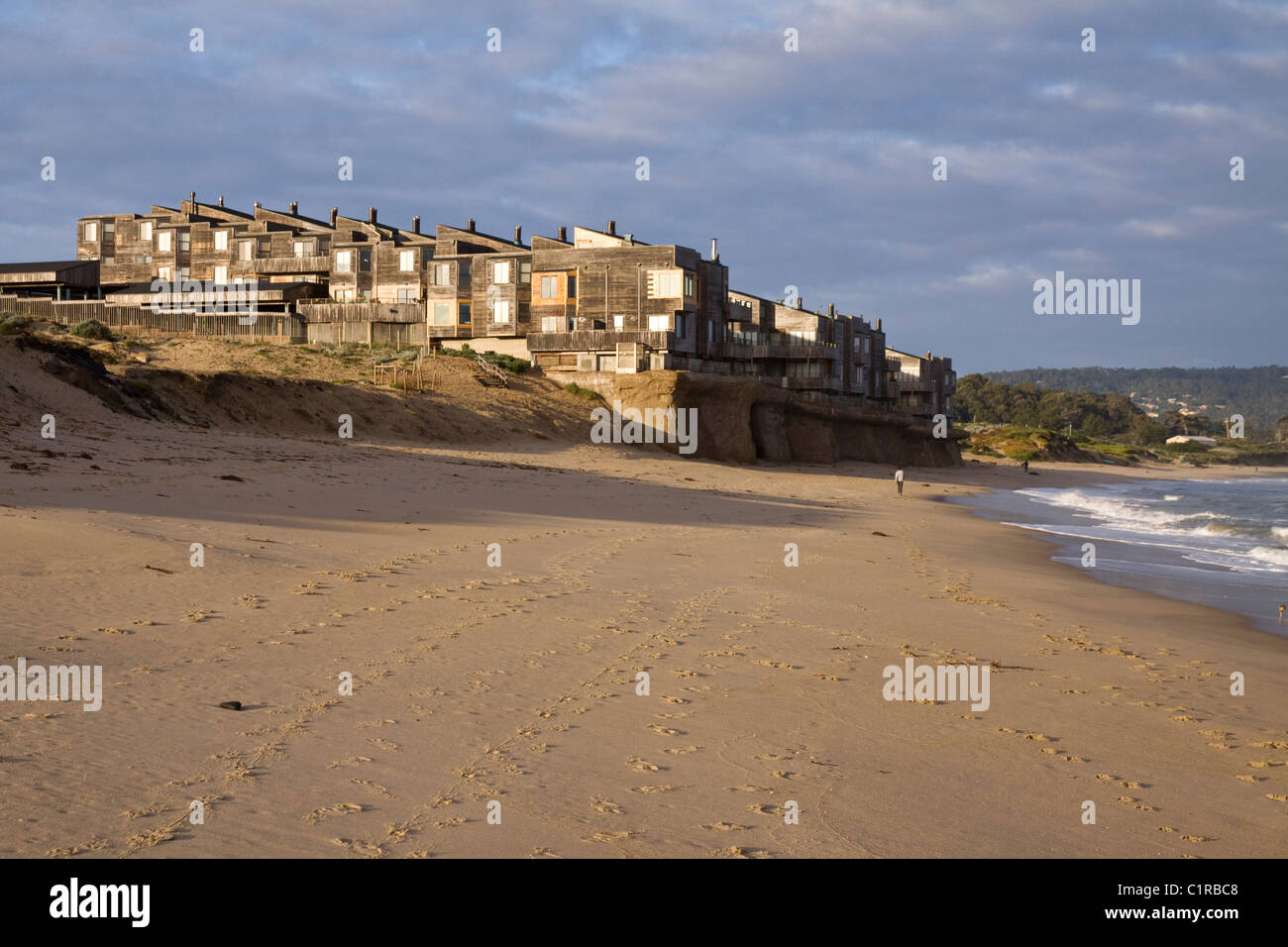 Climate Change. Beachfront condo development being undermined by rising ocean levels, Monterey Bay, California, - Stock Image