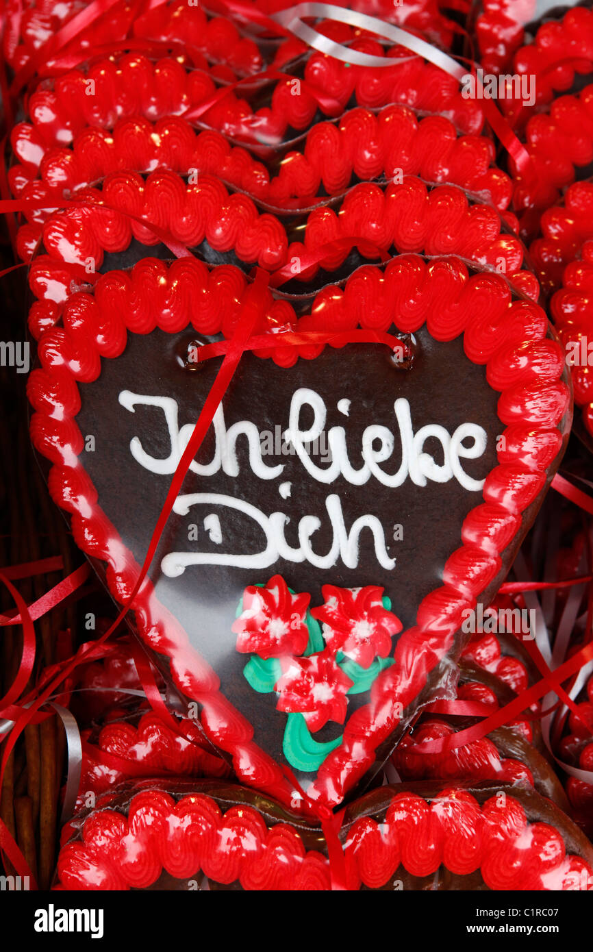 An Oktoberfest gingerbread heart says 'Ich Liebe Dich' meaning 'I love you'. - Stock Image