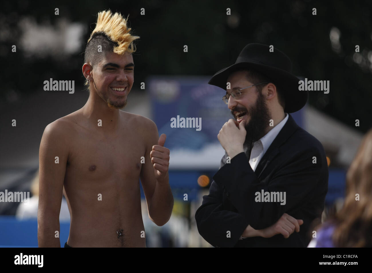 An ultra-Orthodox Jew discussion with a punk boy. Stock Photo