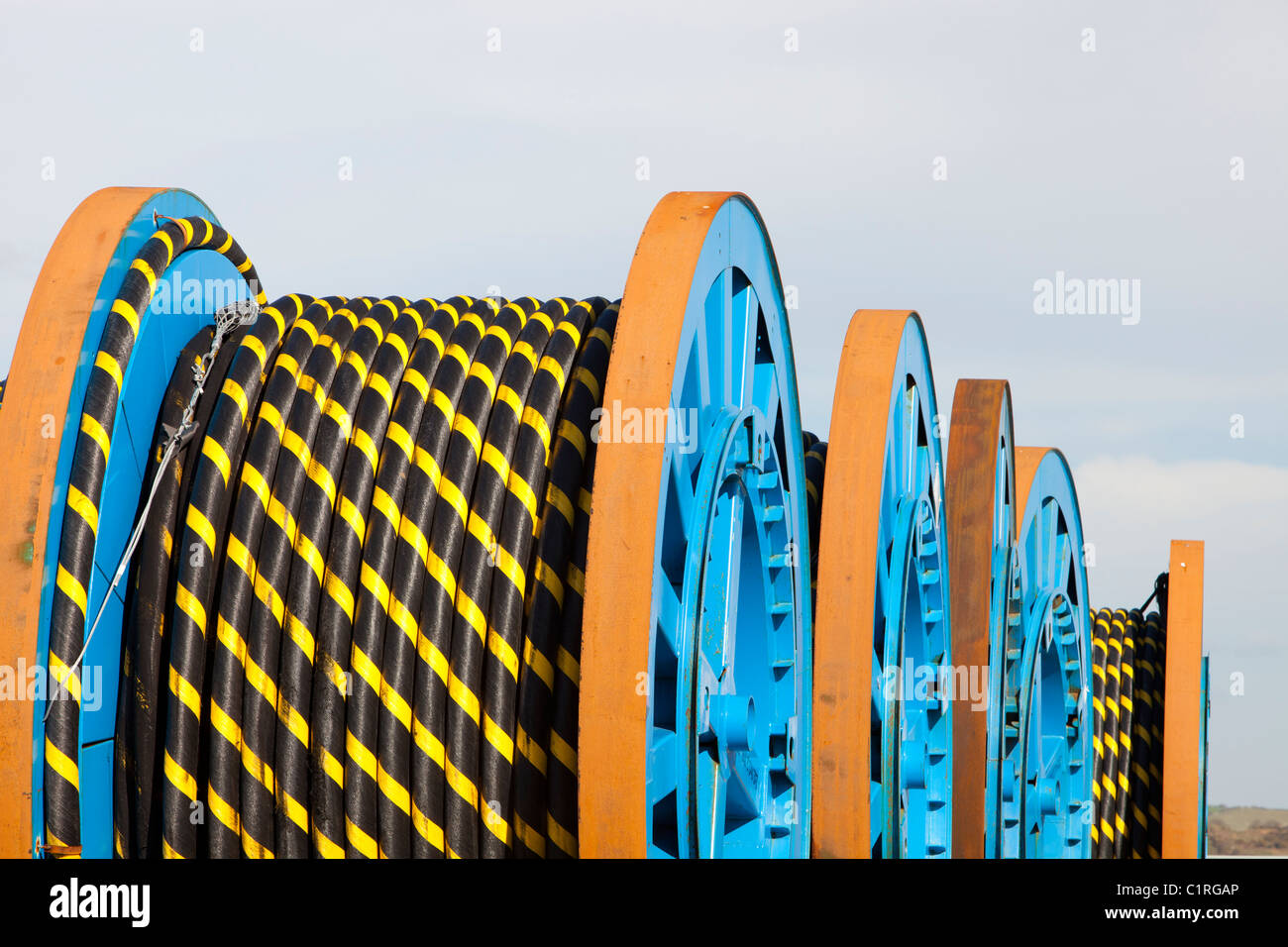 Undersea electric cabling on the dockside in Barrow in Furness, Cumbria, destined for the Walney offshore wind farm. - Stock Image