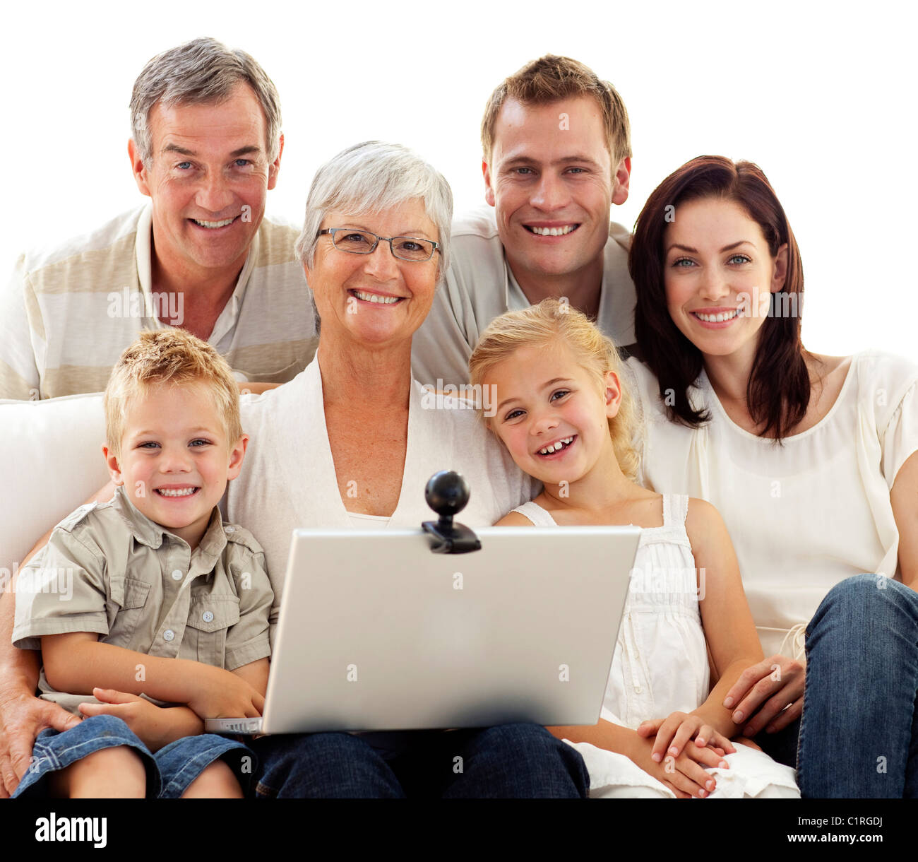 Happy family using a laptop at home - Stock Image
