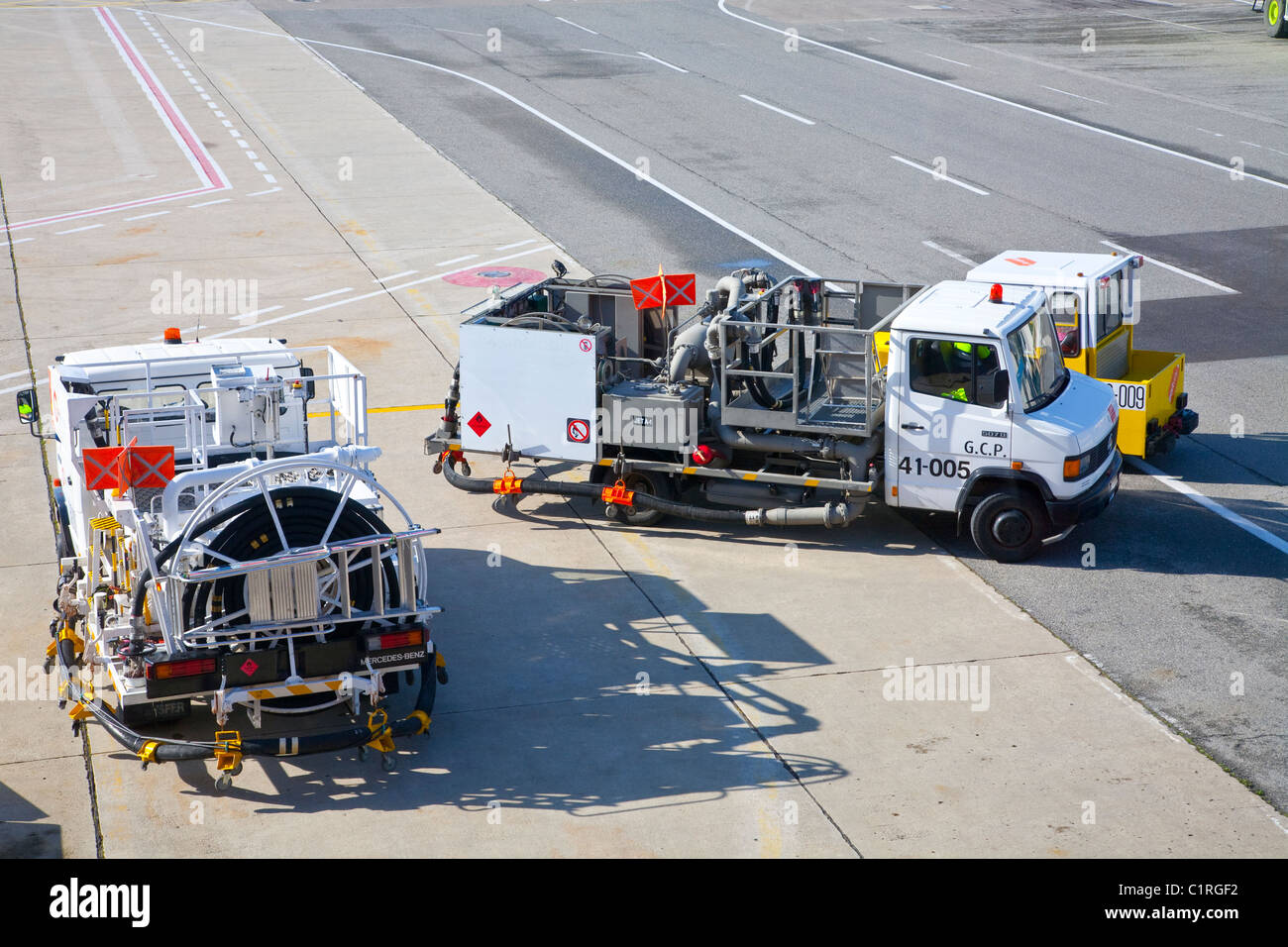 Refueling vehicles at an airport - Stock Image