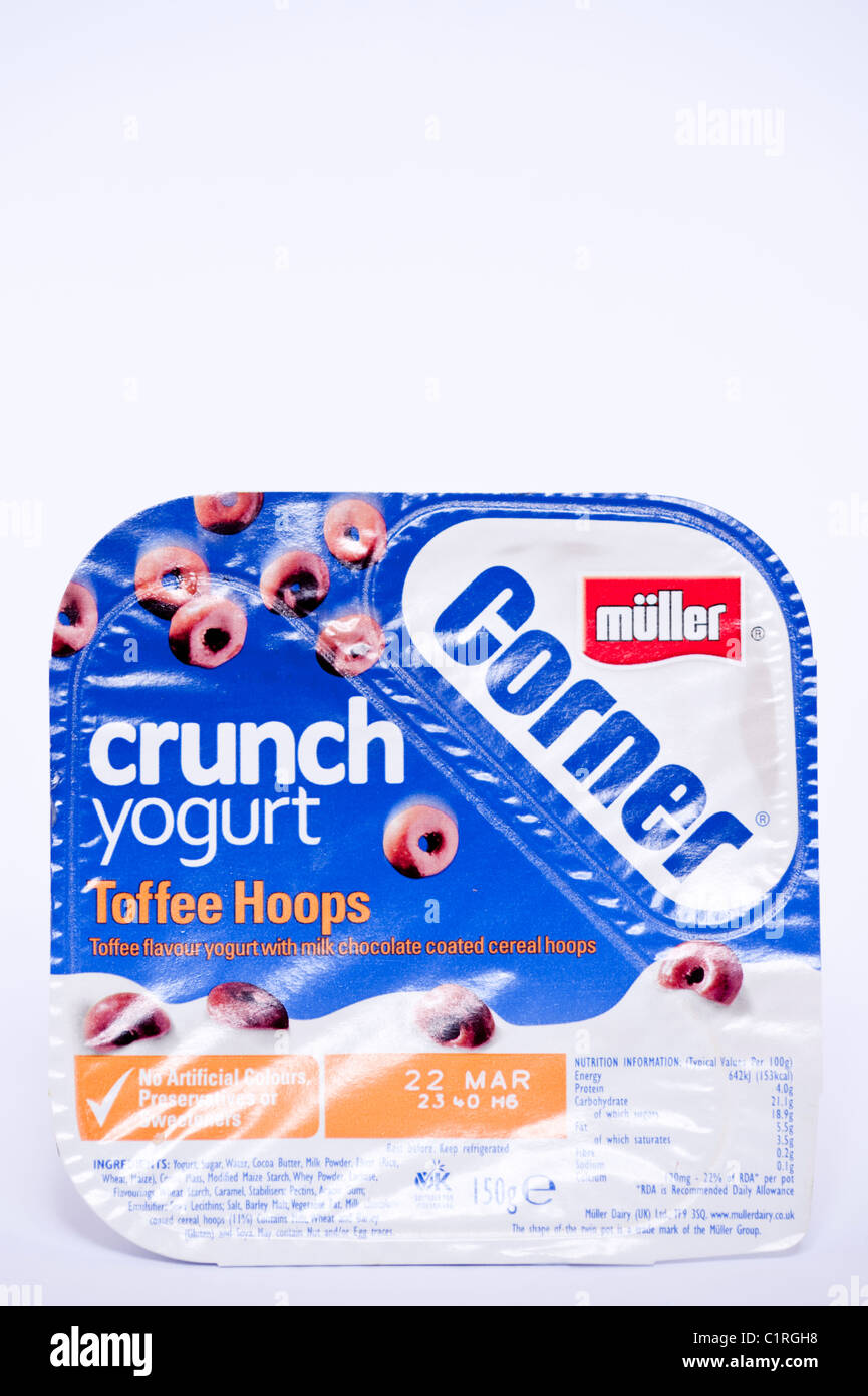A pot of Toffee Hoops Muller Corner crunch yogurt on a white background - Stock Image