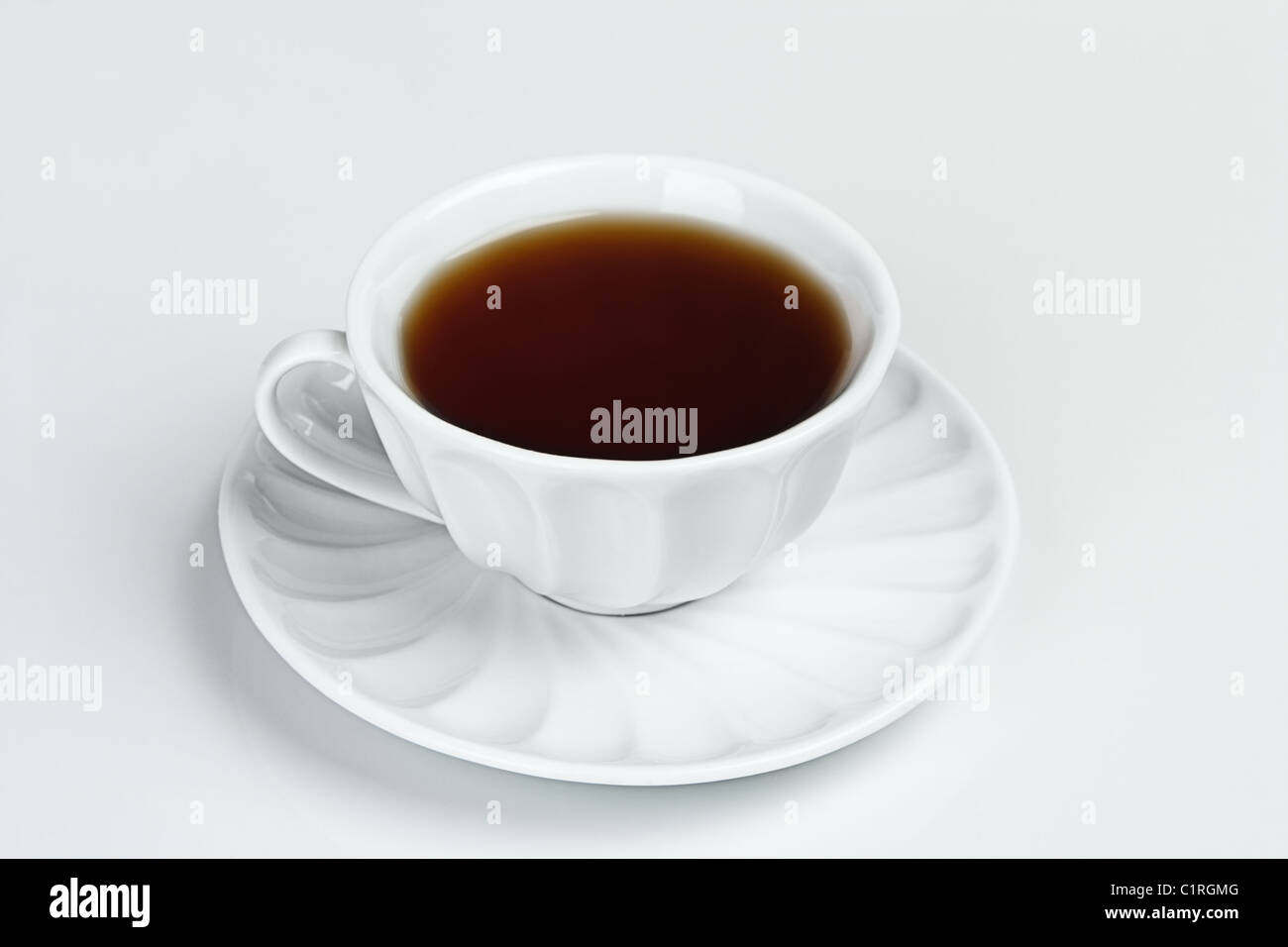 White cup of black tea isolated Stock Photo