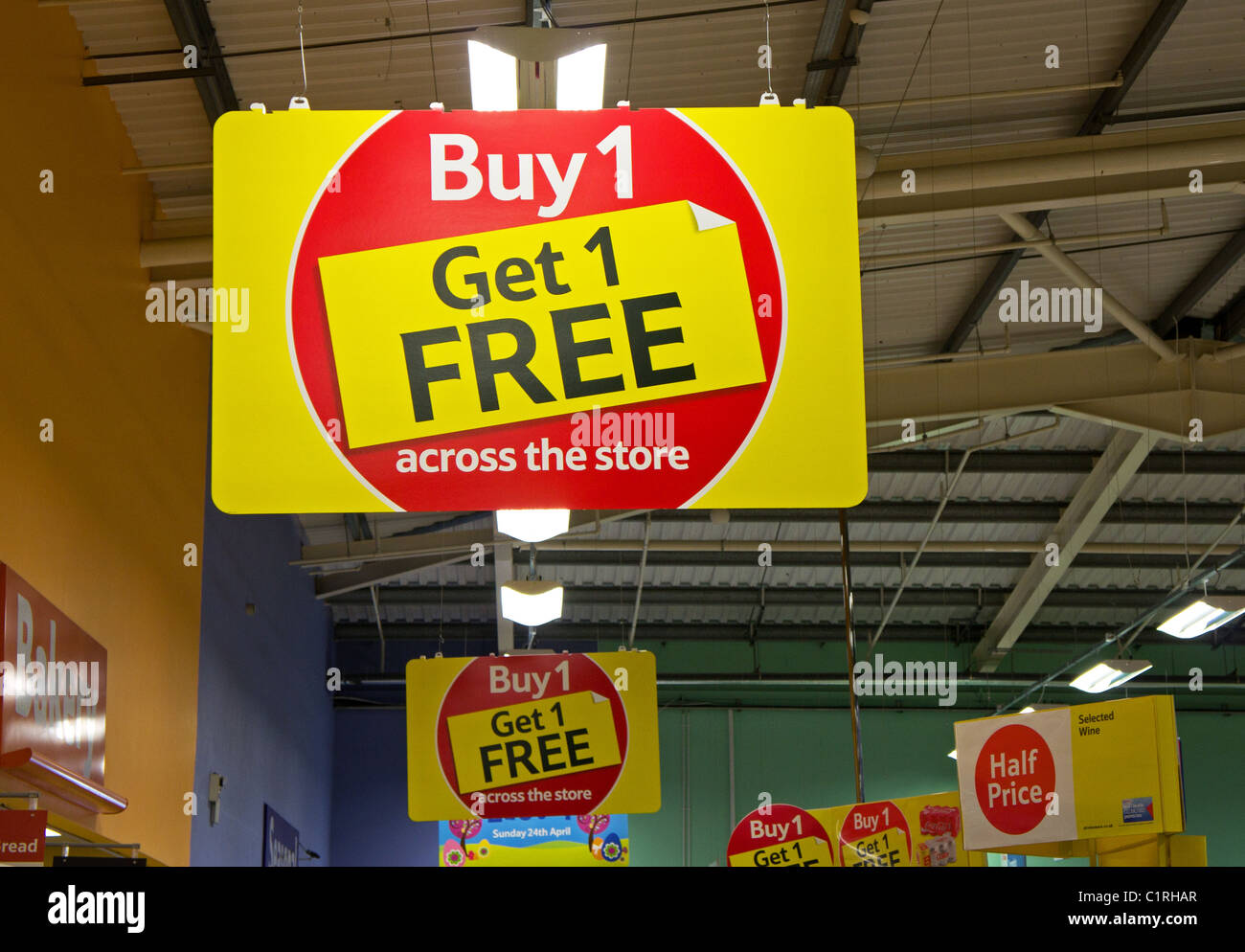 A buy 1 get 1 free sign in a Tesco supermarket, UK - Stock Image