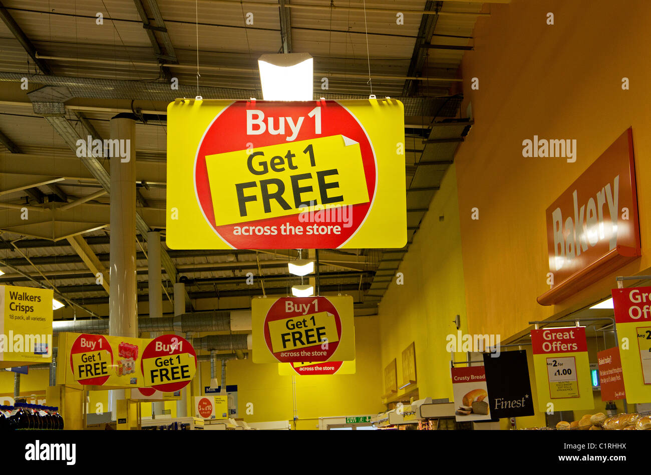 Buy 1 Get 1 free posters in a Tesco supermarket, UK - Stock Image