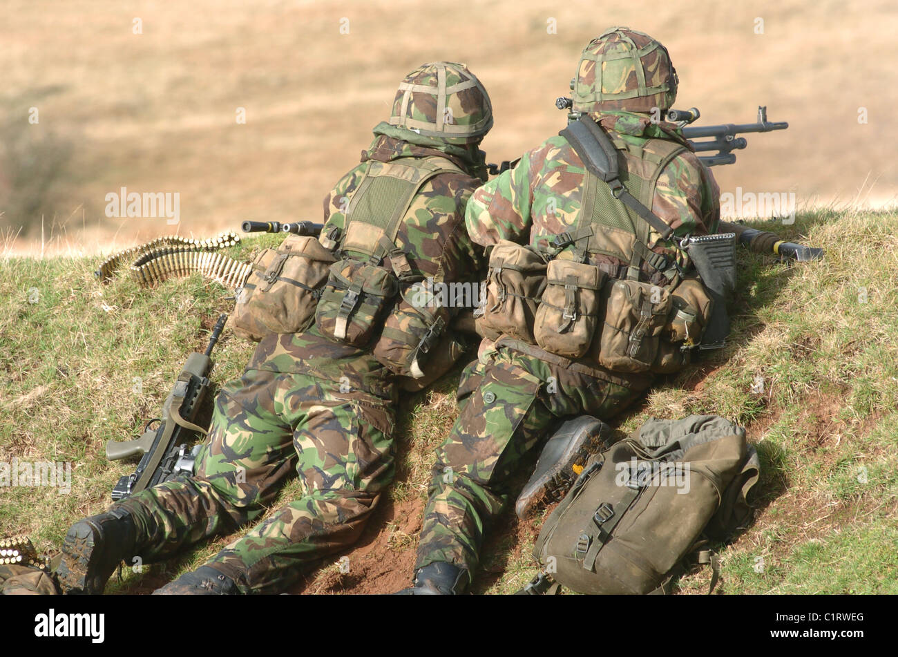 British Army soldiers participate in sustained fire training. - Stock Image