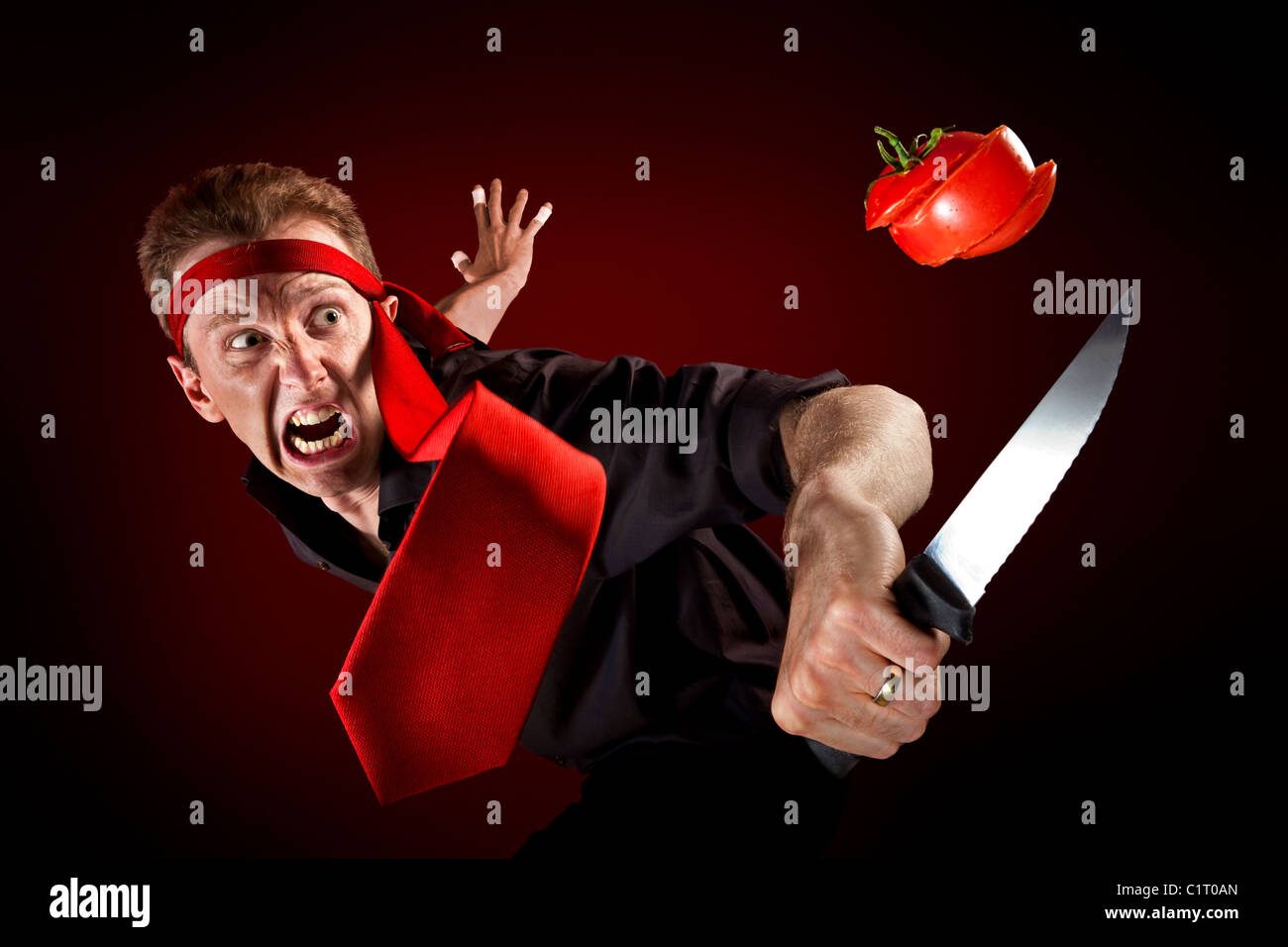 A man wrapped his tie around the head and acts like a ninja a man wrapped his tie around the head and acts like a ninja cutting in pieces a tomato mid air ccuart Image collections