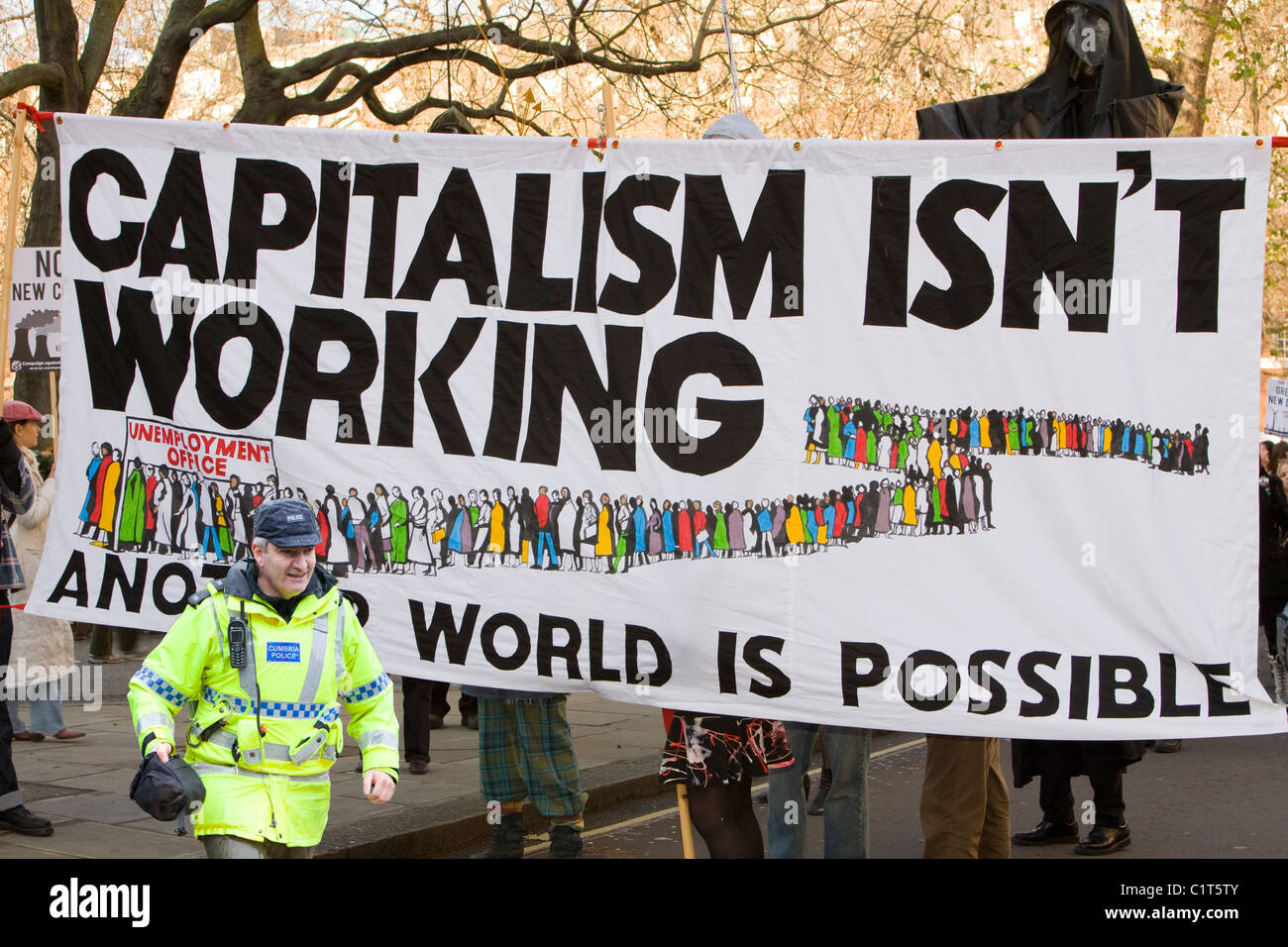 Protestors at a climate change rally in London December 2008 with a policeman. - Stock Image