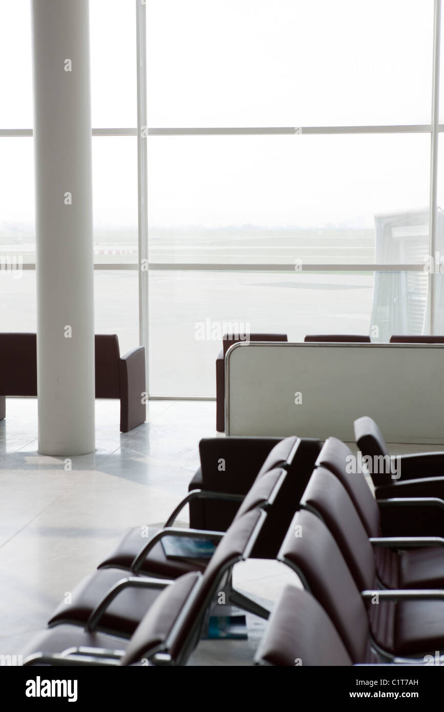 Empty waiting area in airport terminal - Stock Image