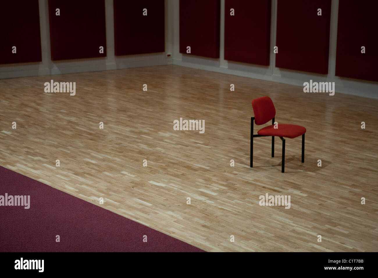Lone chair in empty room - Stock Image