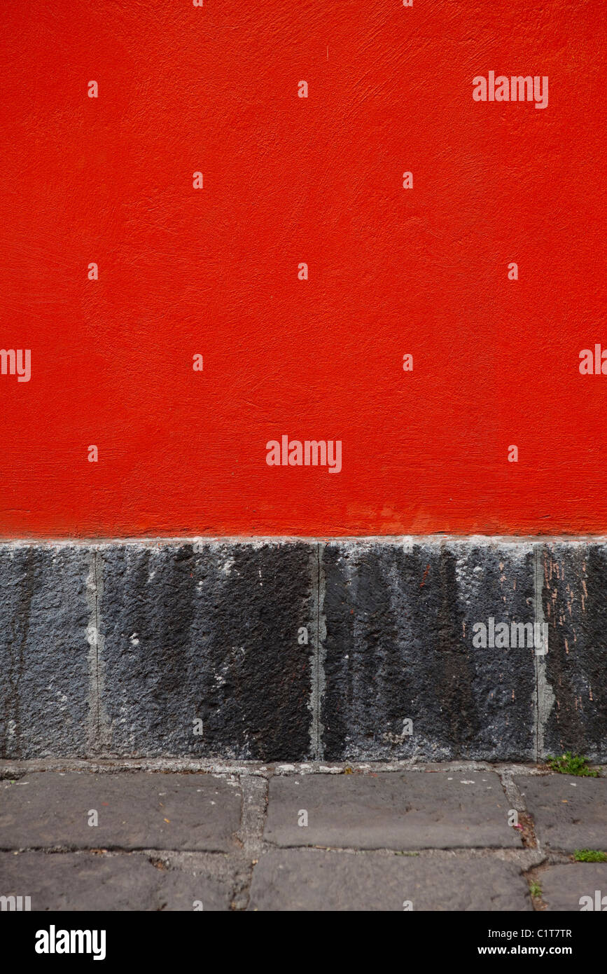 Red stucco wall, close-up Stock Photo