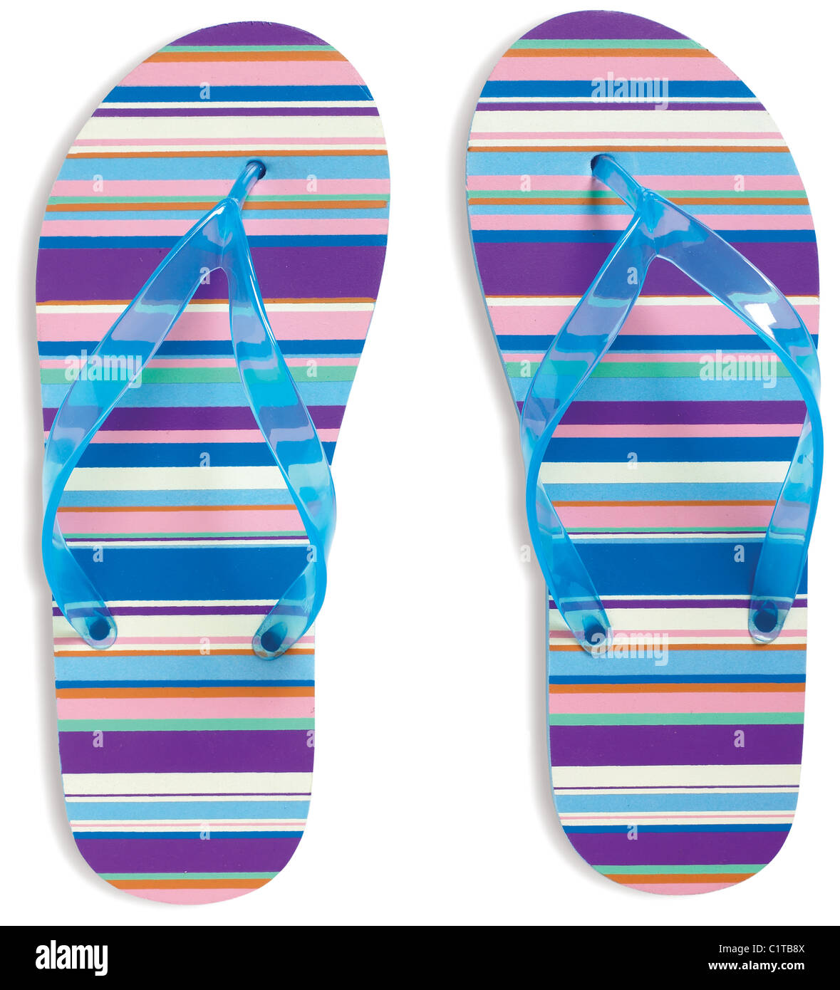 pair of stripy flip flops strings isolated on a white background with clipping path - Stock Image