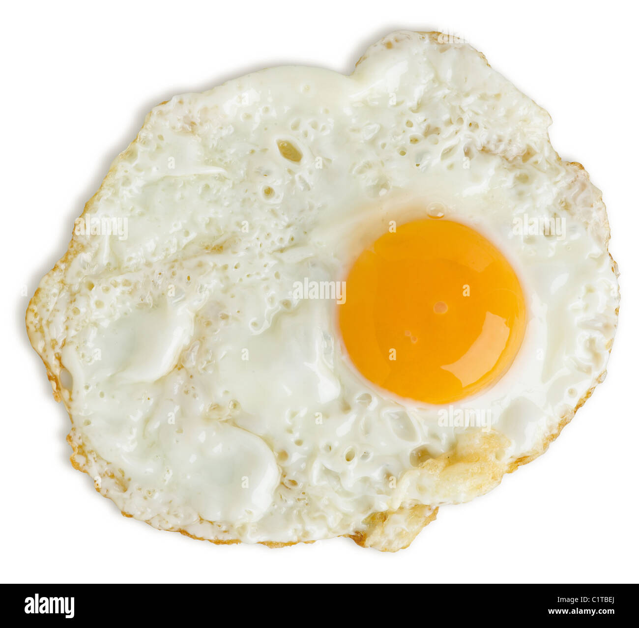 a badly fried egg isolated on white with a clipping path - Stock Image