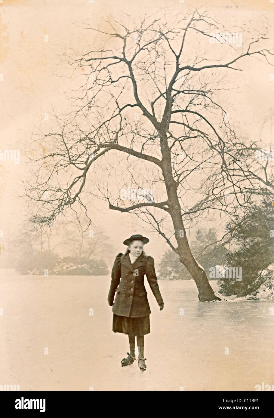 Historical photograph taken in  January 1895 of girl on ice skates on pond near Castleton Derbyshire England UK - Stock Image
