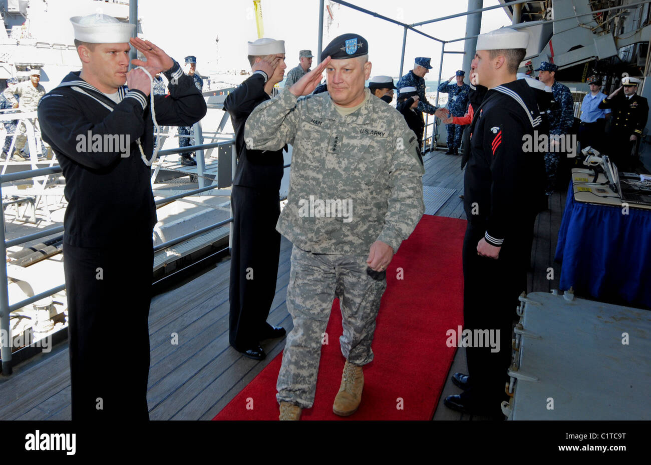 Gen. Carter F. Ham, commander of U.S. Africa Command, is piped aboard the amphibious command ship USS Mount Whitney - Stock Image