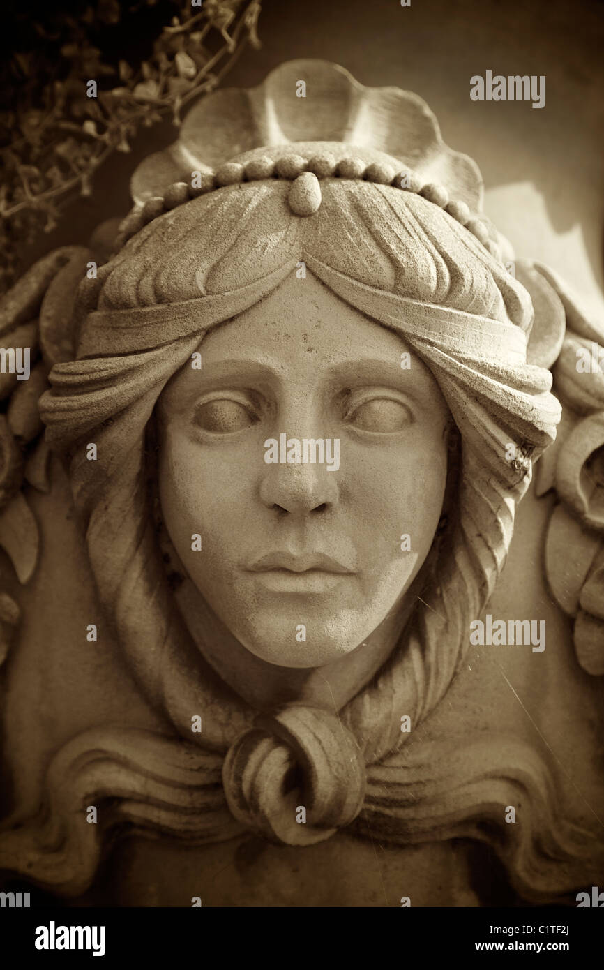 A stone carving on a large urn. - Stock Image