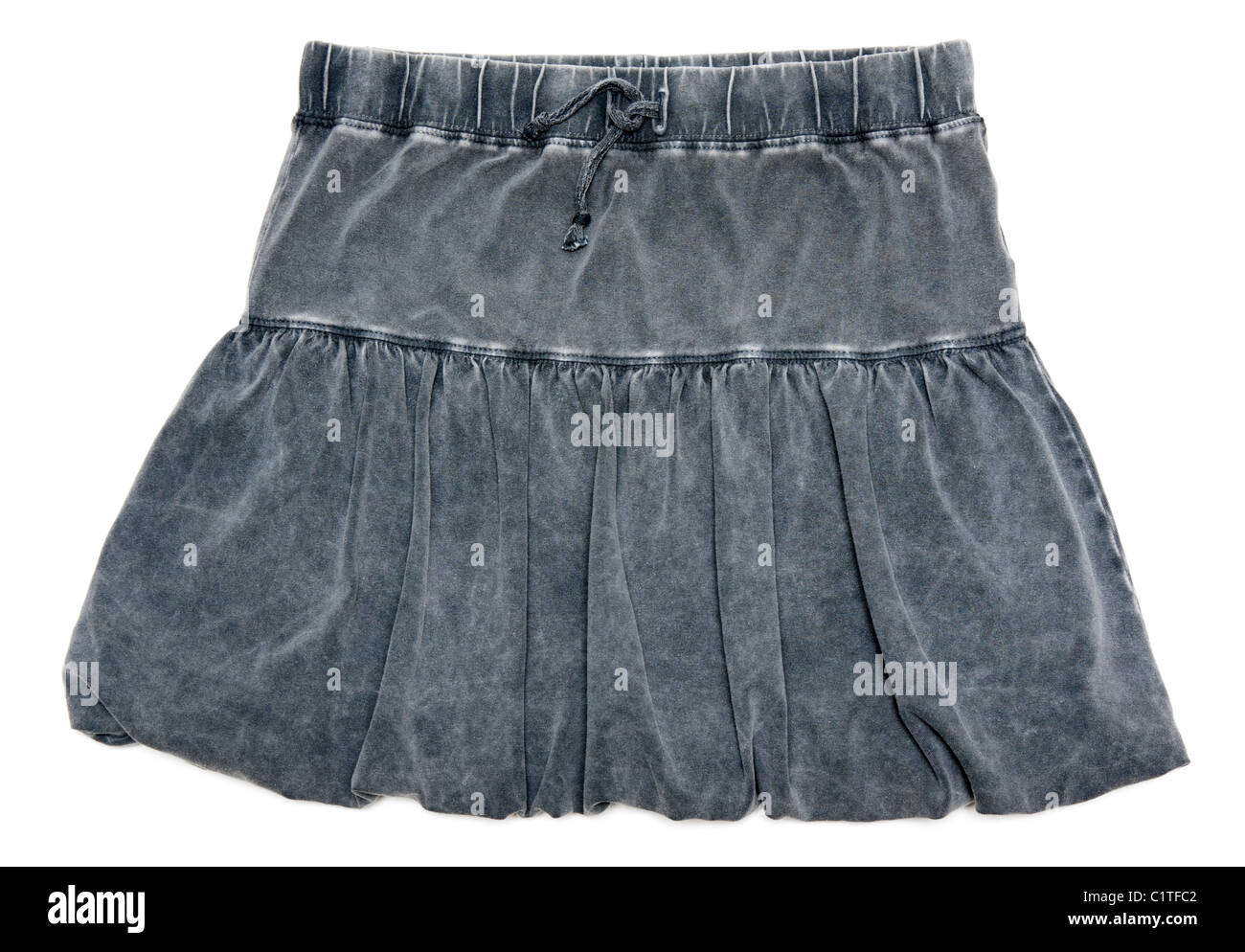 Gray feminine skirt insulated on white background - Stock Image