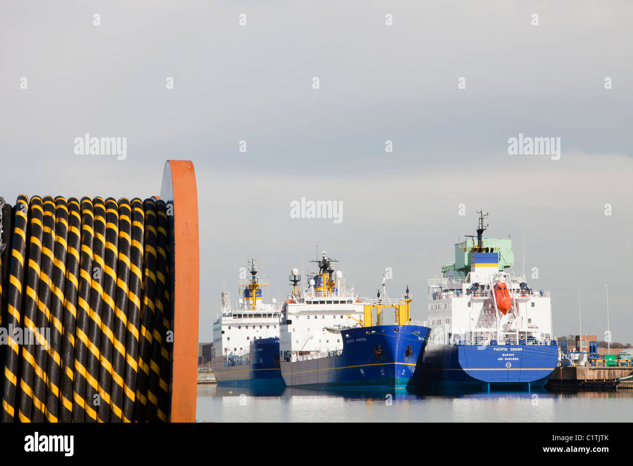 Undersea electric cabling on the dockside in Barrow in Furness, Cumbria for the Walney offshore wind farm. - Stock Image