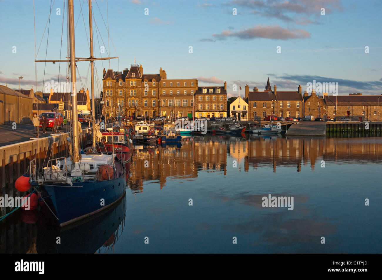 Kirkwall Harbour Orkney Scotland with pleasure and fishing boats moored at the pier on a sunny June evening - Stock Image