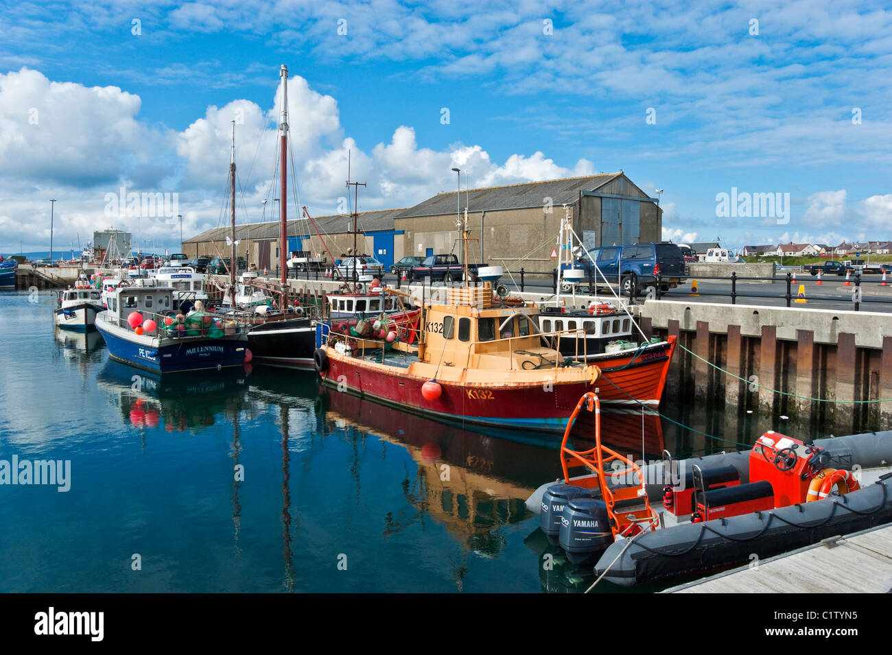 Kirkwall Harbour Orkney Scotland with fishing boats moored at the pier on a sunny June day - Stock Image