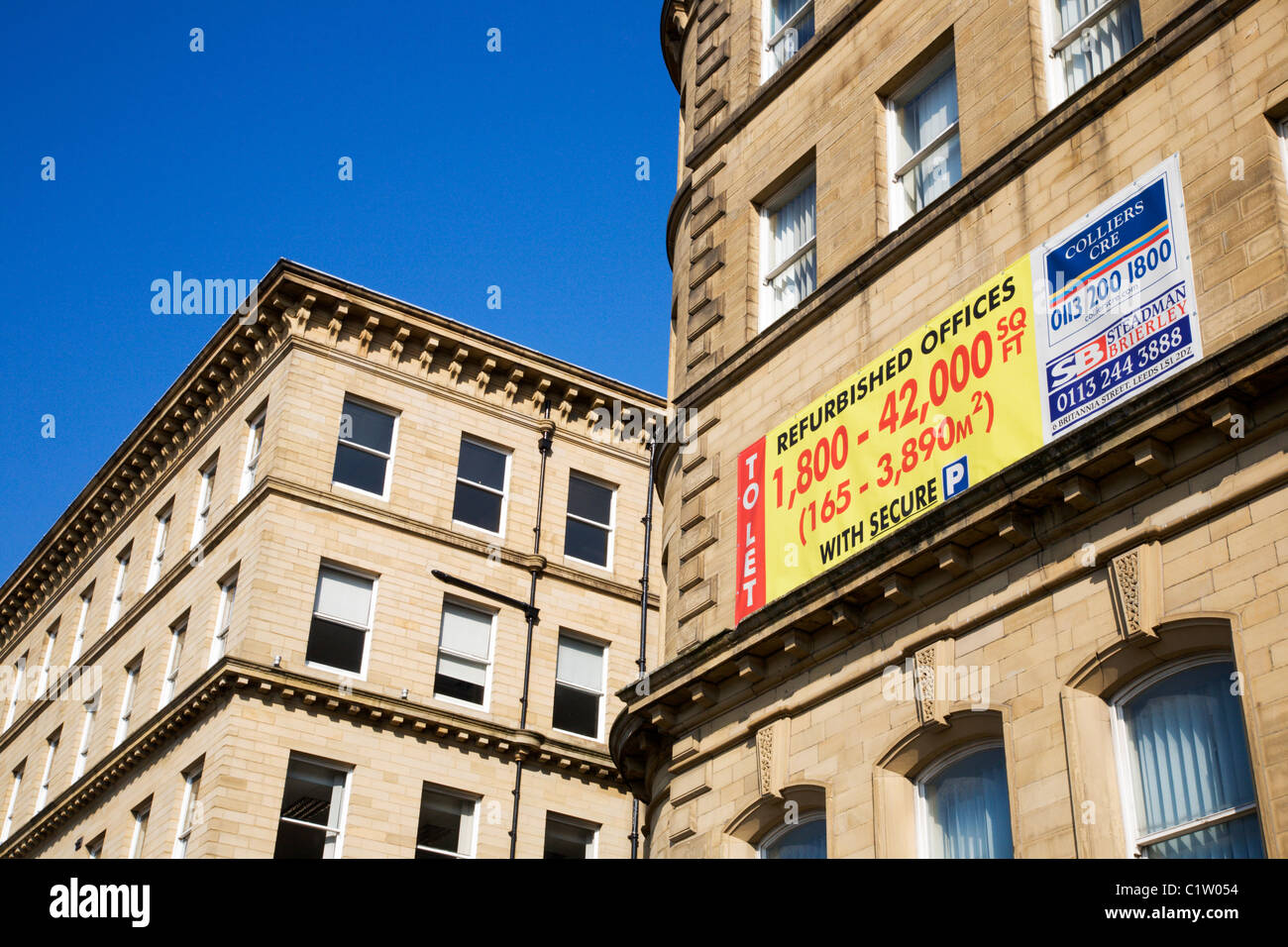 Refurbished Offices To Let Sign on Well Street Bradford West Yorkshire England - Stock Image