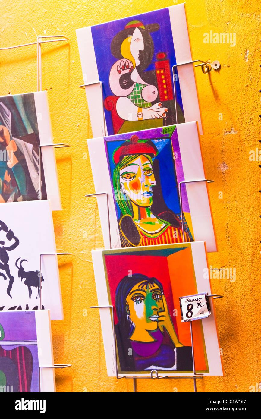 Malaga, Spain. Souvenir copies of Pablo Picasso paintings outside souvenir shop. - Stock Image