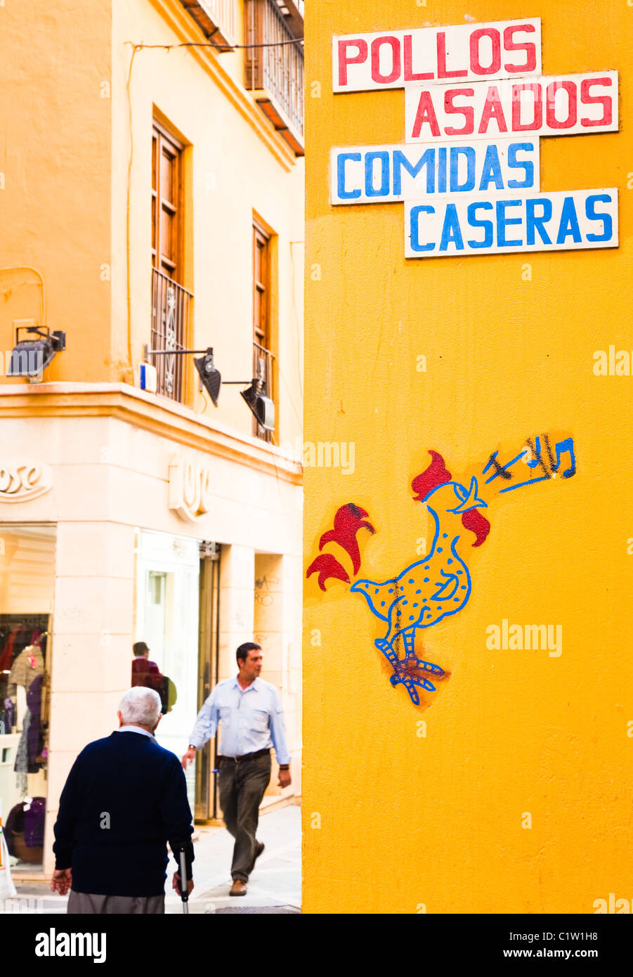 Sign for roast chicken and home cooked meals in back street Malaga,  Spain. - Stock Image